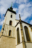 Church bell tower. Looking up at the bell tower, belfry or steeple of an old church in Prague, Czech Republic Royalty Free Stock Photos