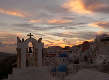 Church bell-tower against pastel color of evening sky at Oia village, Santorini Island. Greece Royalty Free Stock Photography