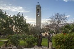 Church Bell Tower with Cross in McAllen, Texas. Blue skies and light clouds royalty free stock photos