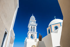 The church and the bell tower in Fira town Stock Image