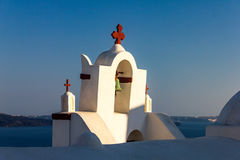 Church bell tower. Greek orthodox church bell tower in the town of Oia in Santorini Stock Images