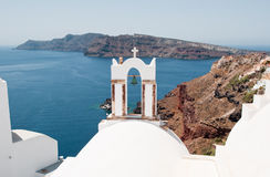 The church with the bell tower on the island of Santorini, Oia. Greece. The church with the bell tower on the island of Santorini, Oia Royalty Free Stock Photos