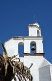 Church Bell Tower Mexico. White adobe church bell tower and palm tree in San Miguel de Allente, Mexico Royalty Free Stock Photos