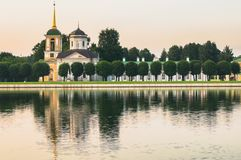 Church with bell tower in museum-estate Kuskovo, Moscow. The estate belonged to the counts Sheremetev and intended for magnificent receptions and crowded Stock Photos