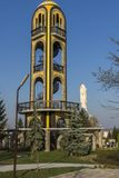 Church bell tower near Monument of Virgin Mary in City of Haskovo , Bulgaria Stock Photo