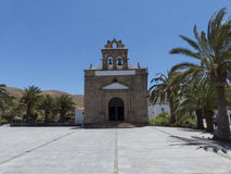 Church with bell tower and palm trees. Royalty Free Stock Photography