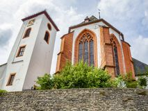 Church bell tower and part of the Church of St. Nicholas in Neuerburg, Rhineland-Palatinate, Germany. Low angle view royalty free stock photography