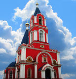 Church with a bell tower. Red Church with a bell tower royalty free stock image