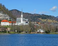 Church with Bell Tower on the shore of Lake BLED Stock Photo