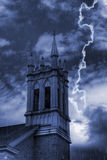 Church Bell Tower in Storm. Rain and lightning on a stormy night over the church bell tower Stock Photo