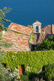 Church bell tower and tiled roof on seaside Stock Image