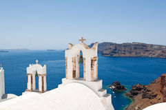 The church with the bell towers on the island of Santorini, Oia. Greece. The church with the bell towers on the island of Santorini, Oia Royalty Free Stock Images