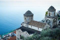 Church belltowers in Ravello village , Amalfi coast of Italy. Church bell towers in Ravello village on sea background, Amalfi coast of Italy royalty free stock photos