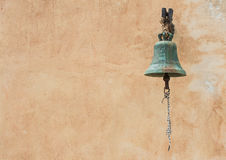 Church bell and wall on background Royalty Free Stock Image