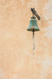 Church bell and wall on background Stock Photos