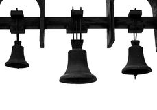 Church bells against a white sky. Black Church bells on the background of white sky Stock Photo