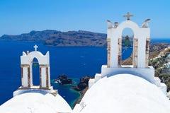 Church bells on Santorini. Architecture of Oia village at Santorini island, Greece Stock Photo
