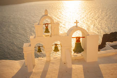 Church bells at sunset, in Oia, Santorini Royalty Free Stock Images