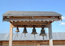Church bells on a wooden belfry of the Sacred and Troitsk Trifonov-Pechengsky man's monastery Royalty Free Stock Photography