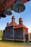 Church and belltower. Ancient wooden church with a belltower. Ukraine, Kiev, a museum open-air Pirogovo royalty free stock image