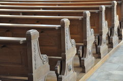 Church benches. Wooden church benches in rows Stock Image