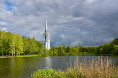 Church in a birch grove on the lake shore Royalty Free Stock Photos