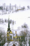 Church with black steeple in winter snow in East Orange, VT Royalty Free Stock Image