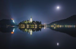 Church and Bled Castle on Bled Lake in Slovenia at Night Stock Photos