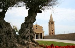 Church of the Blessed Virgin of the Angel, Caorle. Caorle is a coastal town in the province of Venezia in Italy, situated on the Adriatic Sea . Behind a big royalty free stock image