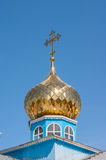 Church. Blue  cross dome gold Stock Photography