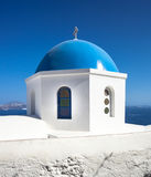 Church with blue cupola at Oia Village, Santorini island. Stock Photo