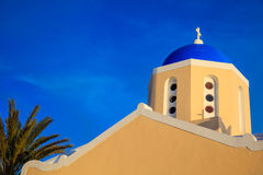 Church with blue dome in Santorini, Greece. Santorini, Greece - Church with blue dome on blue sky background Royalty Free Stock Image