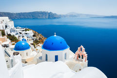 Church with blue domes in Oia town. Santorini island, Greece Stock Photos