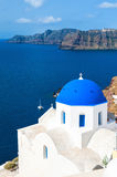 Church with blue domes in Oia town, Santorini island, Greece Royalty Free Stock Photography