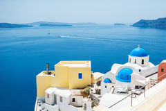 Church with blue domes in Oia town, Santorini island, Greece Stock Images