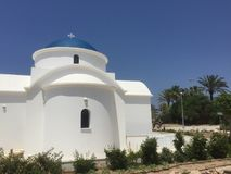 The church with the blue roof. The end of the beach Royalty Free Stock Photos