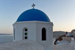 Church with blue roof in town of Oia and panorama to Santorini island, Thira, Greece Stock Photography
