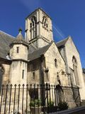 A church in blue sky in England. A cotswold church in the summer Royalty Free Stock Image