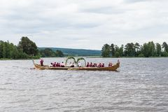 Church boat in Sweden arriving to celebrate midsummer. In a Swedish traditional manner Stock Image