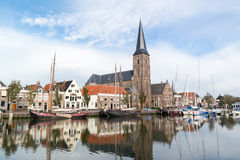 Church and boats in south harbour canal of Harlingen, Netherland Royalty Free Stock Photography