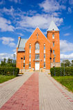 Church and brick walkway. Church with a long brick walkway leading to the door Stock Photography