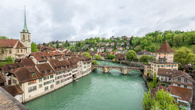 Church, bridge and houses with tiled rooftops, Bern Stock Images