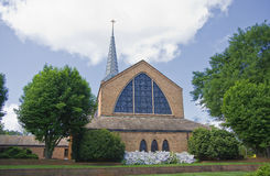 Church Building. Brick church and steeple in the summer royalty free stock photo