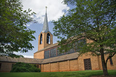 Church Building. Brick church and steeple in the summer royalty free stock image