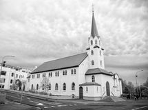 Church building on cloudy sky in Reykjavik, Iceland. Church building with white walls and green roof on cloudy sky in Reykjavik, Iceland. Architecture, landmark royalty free stock photo