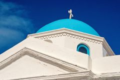 Church building detail Mykonos, Greece. Chapel with cross on blue dome with nice architecture. Agios Nikolaos church on. Sunny sky. Summer vacation on royalty free stock images