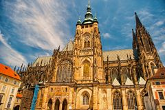 Church building in prague, czech republic. St.vitus cathedral on cloudy blue sky. Monument of gothic architecture and royalty free stock image