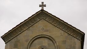 Church building with religious decorative details on wall, symbolism in artwork. Stock footage stock footage