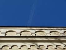 Church building wall in diminishing perspective. Church building wall with arched under blue sky in diminishing perspective royalty free stock photos
