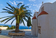 Church buildings, palm and cypress trees inside Preveli monastery, island of Crete Stock Photography